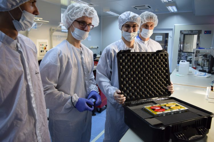 Members of the PW-Sat2 team (Piotr Kuligowski, Dominik Roszkowski, Mateusz Sobiecki, Maciej Kania) are securing the satellite in a special case before bringing it out from the cleanroom. Photo: Michał Gumiela/PW-Sat2/Astronautic Student Research Group
