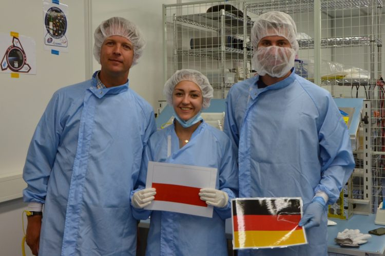 A photo to commemorate the successful integration. In the photo, left to right: Michiel van Bolhuis, representative of ISL; Inna Uwarowa, PW-Sat2 Coordinator; and Martin Langer, Move-II Team Coordinator Photo: PW-Sat2/Astronautic Student Research Group